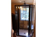 Free standing framed shower enclosure with Bronze frame and clear glass